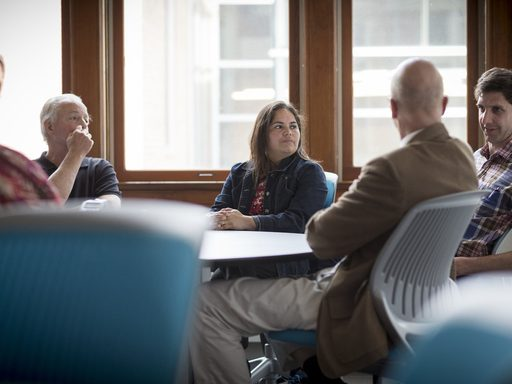 Five professors sitting around a table