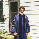 Mark Hansell poses in his academic robe.