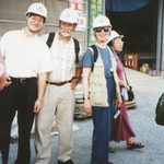 Four faculty wearing hard hats on trip to Asia.