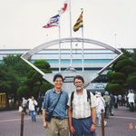 Two people posing outside the Hanshien Koshien Stadium