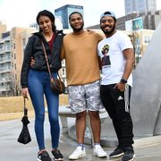 Three students pose for a photo