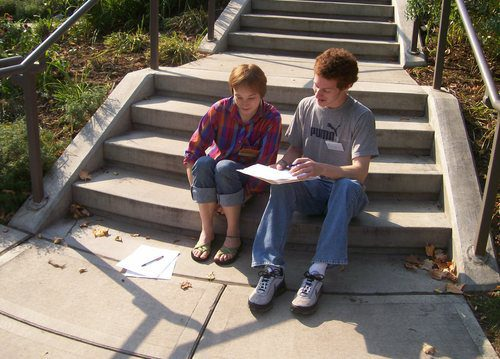 two students on a sunny stairway
