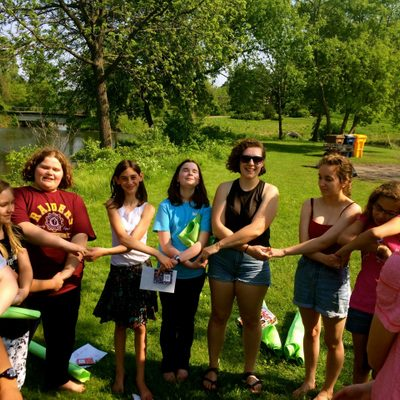 Carleton volunteers get together with middle school girls as friends and positive role models.