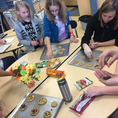 Girls from Northfield Middle School decorate cookies one week during a Girls Circle meeting.