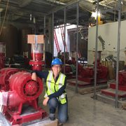 Martha Larson with a water pump in the new East Energy Station in the sub-basement of Anderson Hall.