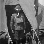 Posing in a gas mask, 1917-19.