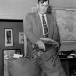 Packing for a return to Antarctica, December 1956.