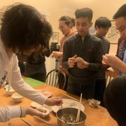 Dumpling making event hosted by OIIL at Dacie Moses House