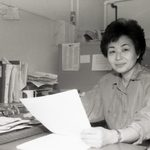 Mariko seated in her Scoville office