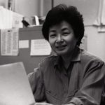 Mariko seated in her Scoville office.