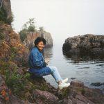 Mariko sitting along Lake Superior cove.