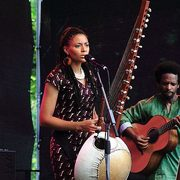 Image of West African musician Sona Jobarteh performing.