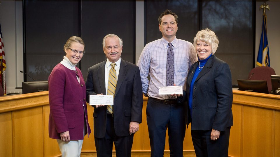 Image of donation checks being given to City of Northfield staff.