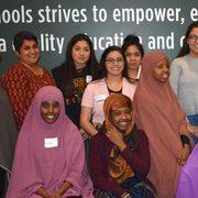 Amel Gorani and Anita Chikkatur along with Faribault high school students.