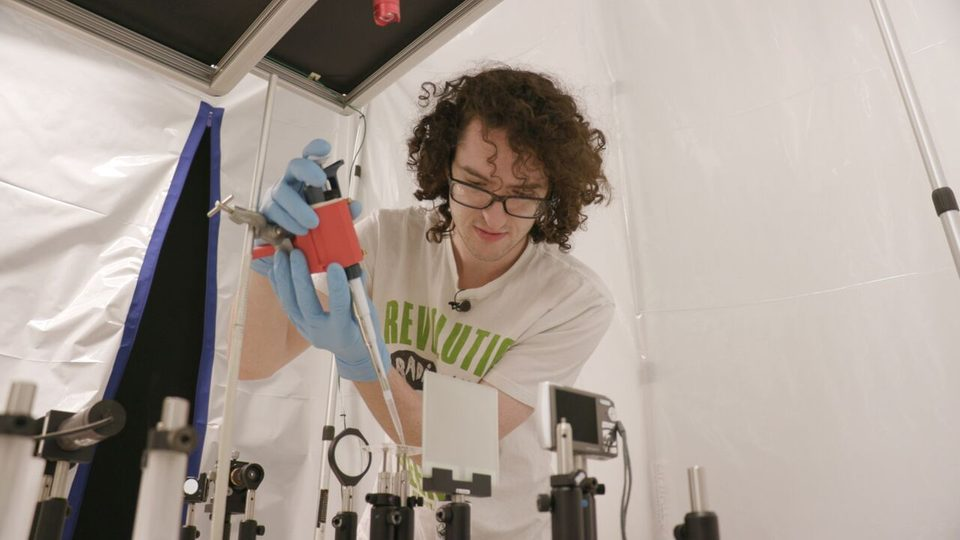 Image of Sam Stevenson '19 working in the lab on his polymer lens research.