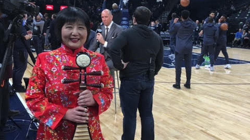 Image of Gao Hong as she waits to perform the national anthem at Target Center.