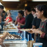 Students sample food from around the world at the 2019 International Festival.