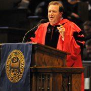 "President Steven Poskanzer readies the audience for ""Carleton, Our Alma Mater."""