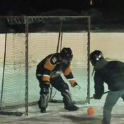 President Poskanzer playing Broomball