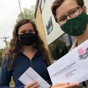 students drop off ballots at City Hall