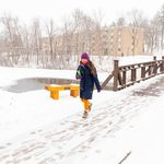 Student walks over Lyman Lakes bridge