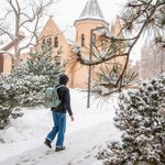 Student walking in front of Scoville Hall