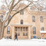 Students walks past Willis Hall in the snow