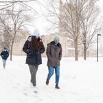 Students walking in the snow outside Skinner Chapel