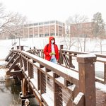Student walking over Lyman Lakes bridge