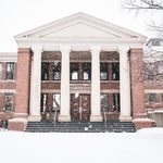 Snow falls outside Sayles-Hill Campus Center