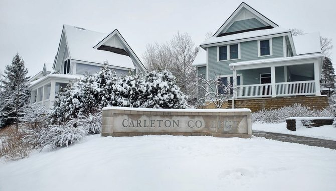 carleton sign in the snow outside the townhomes