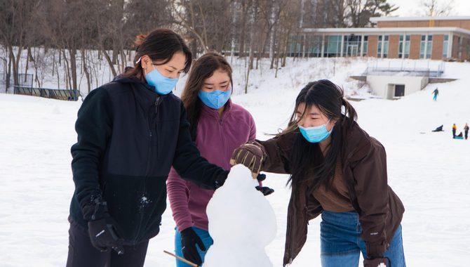 students building a snow sculpture