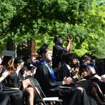 applauding the student speaker