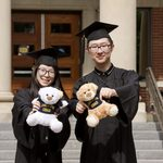 two graduates with