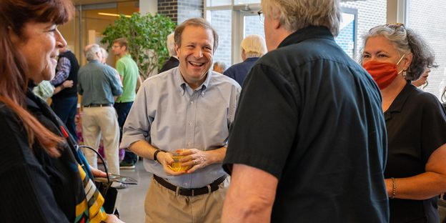 Steve Poskanzer, center, at a reception held in his honor.