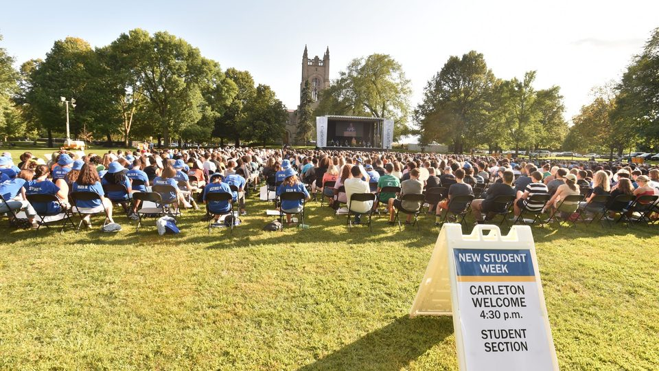 wide shot of the Carleton Welcome student section with the Class of 2025 and the chapel in the background