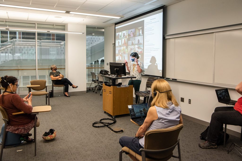 A teacher instructs a mixed mode classroom.