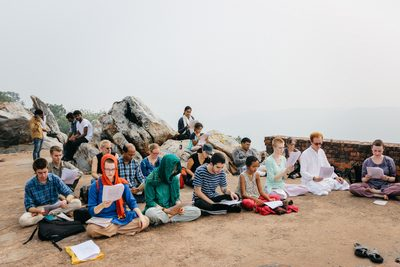 Students studying on a mountain top