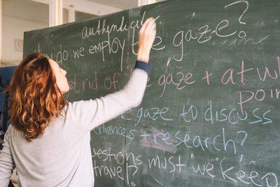 Iveta writing on a whiteboard