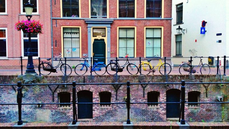 Bicycles line the canal
