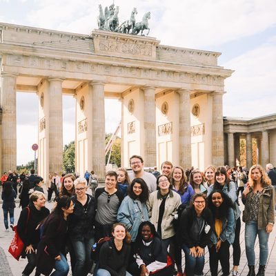 Students posing in a group photo in front of a famous monument