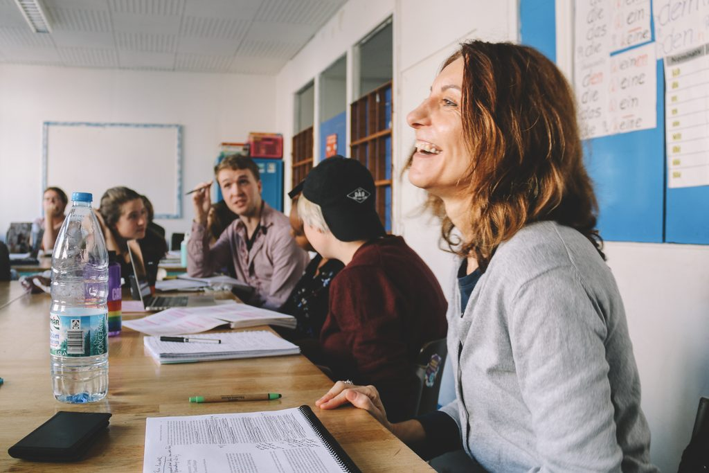 Professor smiling, while leading a class