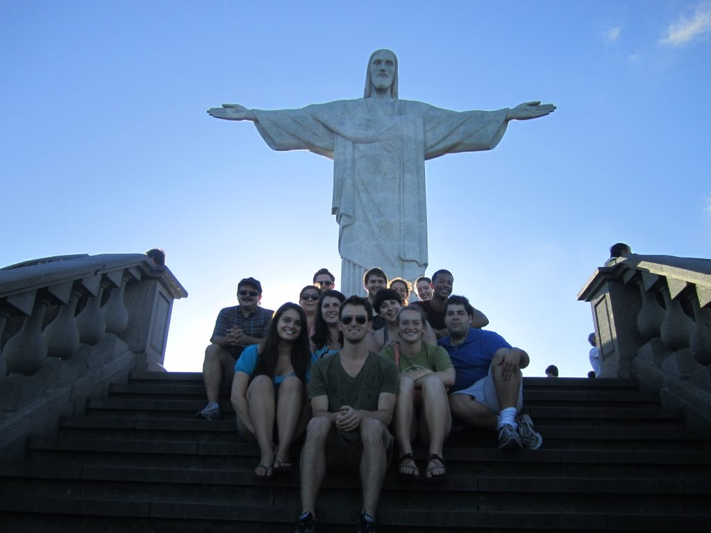 Students pose in front of the Cristo Redentor statue Corcovado Mountain in Brazil