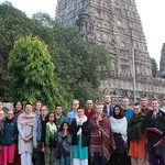 Entire group poses in front of temple