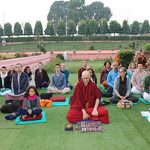 Students meditate in the garden