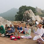 Students study on various rock formations