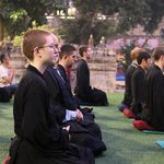 Students meditate outdoors