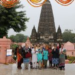 The program group poses in front of the temple