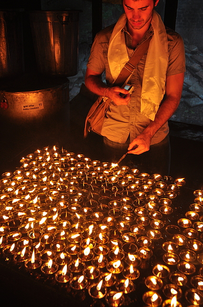 A student lights a candle