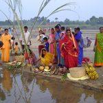 Indian women gather near the water